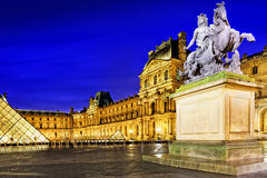 PARIS - SEPTEMBER 17. Glass pyramid and the Louvre museum on Sep Royalty Free Stock Photo
