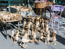 Paris shop detail: Wooden ducks and pigs displayed on sidewalk Stock Photography