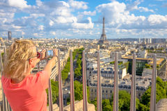 Woman photographs Eiffel Tower Stock Image