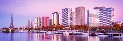 Paris skyline, Eiffel tower and buildings at sunset. Reflection in the river Seine Stock Photos