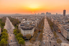 Paris skyline. The famous Champs-Elysées in Paris from the top of the Arc De Triomphe at night Stock Photos