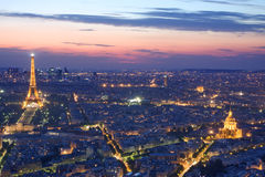 Paris skyline by night. With illuminated Eiffel tower, Invalides, and arc de Triomphe Royalty Free Stock Photography