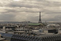 Paris skyline with rooftops and the Eiffel tower on a cloudy day. Paris symbol and iconic landmark. Famous touristic. Places and romantic travel destinations in Stock Images