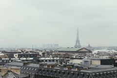 Paris skyline with rooftops and the Eiffel tower on a foggy day. Paris symbol and iconic landmark. Famous touristic. Places and romantic travel destinations in Royalty Free Stock Photography