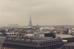 Paris skyline with rooftops and the Eiffel tower on a foggy day. Paris symbol and iconic landmark. Famous touristic. Places and romantic travel destinations in Royalty Free Stock Images