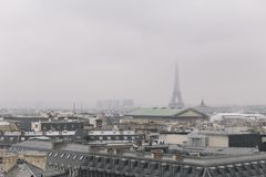 Paris skyline with rooftops and the Eiffel tower on a foggy day. Paris symbol and iconic landmark. Famous touristic. Places and romantic travel destinations in Royalty Free Stock Image