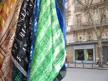 Paris Souvenir Scarves Boulevard Haussmann Paris. Close-up on a bundle of scarves printed with Paris on them, hanging from a souvenir kiosk boulevard Haussmann royalty free stock photography