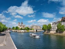 Paris in Spring. Touristic boat on the river passes Ile St Louis Royalty Free Stock Photo