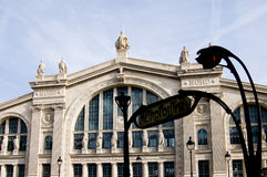 Paris Station Gare du Nord. The station Gare du Nord - North Station - has been restored. The facade is bright white. We see an original 1900 metro sign with Stock Images