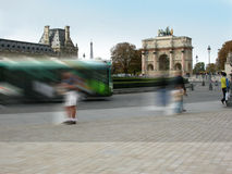 Paris street activity. Activity and bustle on the streets of Paris near the Louvre Museum.  Motion blur Royalty Free Stock Photography