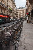 Paris street with bicycles for rent Royalty Free Stock Photography