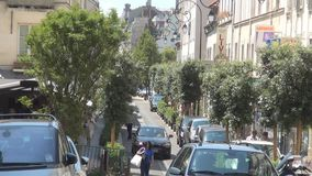 Paris Street Image Rue Ybry with Car Traffic and People Walking on Sidewalk stock footage