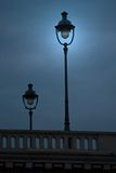 Paris Street Lamps. Street Lamps on a Paris Bridge at Dusk stock image