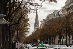 Paris street in late October, with the steeple of the Convocation of Episcopal Churches in Europe Stock Photography
