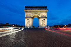 Paris street at night with the Arc de Triomphe in Paris, France. Royalty Free Stock Image