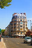 Paris Street with shops and cafe tables. Stock Photography