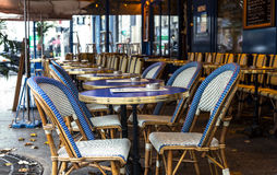 Paris. Street view of a Bistro with tables and chairs. Cafe parisian