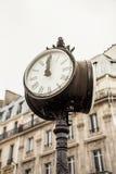 Paris street view detail of a street clock art deco. Paris street view detail of a street clock stock photography