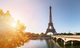 Paris street with view on the famous paris eiffel tower on a sun Stock Images