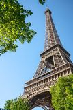 Paris street with view on the famous paris eiffel tower on a sunny day with some sunshine stock photography