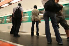 Paris Subway. Passengers and a passing train in the Paris subway stock photos