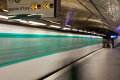 Paris subway station with  speeding train blur, France Royalty Free Stock Photography