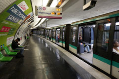 Paris Subway Train Stop. Photo of train at a subway stop in paris france on 9/13/14.  The paris subway system covers the entire city Royalty Free Stock Photo