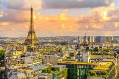 Eiffel Tower skyline. Paris sunset skyline aerial view from top of Arc de Triomphe on Champs Elysees street. Distant Tour Eiffel tower Landmark in Paris, France Stock Images