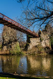 Paris - The suspension bridge - Parc des Buttes Chaumont royalty free stock photography