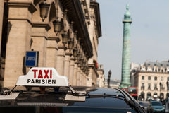 Paris taxi. Ancient building in Paris, near the town in a taxi in Paris Stock Photos