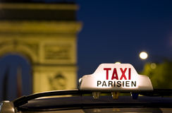 Paris taxi. Taxi near the Arc de Triomphe in Paris Stock Images
