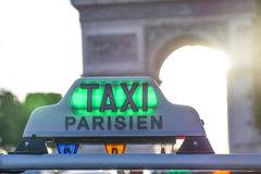 Paris taxi detail and Arc de Triomphe in the background. France Royalty Free Stock Photo