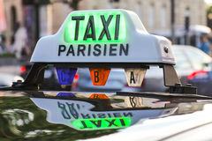 Paris taxi detail and Arc de Triomphe in the background Royalty Free Stock Image