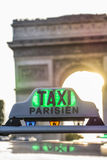 Paris taxi detail and Arc de Triomphe in the background Royalty Free Stock Photography