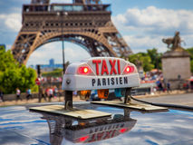 Paris taxi near Eiffel Tower Royalty Free Stock Image