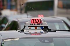Paris Taxi sign. On a cloudy rainy day Royalty Free Stock Photos