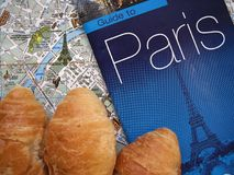 Paris theme. France symbols flat layout background. Symbols of Paris and France in flat layout or background. Croissants, Eiffel tower, guide to Paris with map Royalty Free Stock Photos