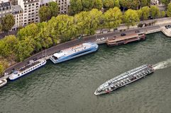 Paris tourism on water. Boat on Seine river, view from Eiffel tower, Paris Stock Image