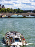 Paris- Tourist boat on the river Seine in front of Pont Neuf Bridge Royalty Free Stock Photography