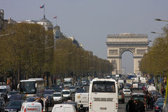 Paris traffic at Arc de Triomphe. Afternoon traffic in Paris Arc de Triomphe along the Champs-Elysees at the Place Charles de Gaulle. Congested city steet Royalty Free Stock Photos
