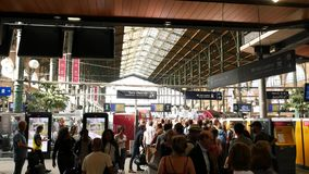 Paris Train Station Paris Gare du Nord. PARIS, FRANCE - CIRCA 2017: Paris Gare du Nord railway train station with people commuting with luggage to the fast stock video footage