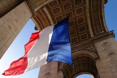 Paris triumph arch. Paris french flag on triumph arch Royalty Free Stock Photo