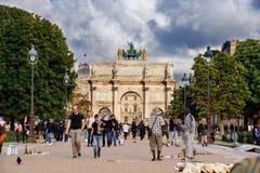 Paris Triumphal arc near Louvre. Paris, France - August 9, 2017. Paris Triumphal arc located near Louvre and Tuileries gardens in summer. Popular touristic Stock Photo