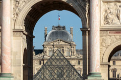 Paris - Triumphal Arch and Glass Pyramid in Louvre Stock Photos