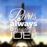 Paris typographic design on blurred Eiffel tower Royalty Free Stock Images