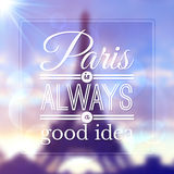 Paris typographic design on blurred Eiffel tower Royalty Free Stock Photography
