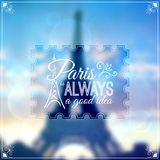 Paris typographic design on blurred Eiffel tower Royalty Free Stock Photo