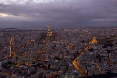 Paris vid natt med moln royaltyfria foton