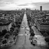 Paris - a view. Av. de la Grande Armee, Paris, France. View from the top of the Arc de Triomphe; sunset Royalty Free Stock Photo