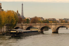 Paris view with Eiffel tower. Paris view with landmarks including the Eiffel tower Tour de Eiffel, Seine river and bridge over it by an autumn day Stock Photos